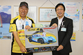 Nobuhiro Tajima reports to Iwata City Mayor of the great achievements at PPIHC2015 by EVs